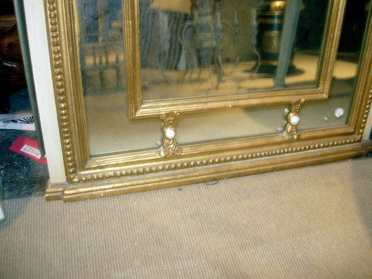 Regency Style Mirror with Painted and Giltwood Decoration In Excellent Condition For Sale In Buchanan, MI