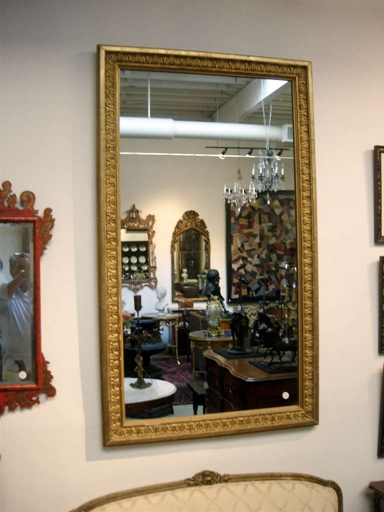 Continental giltwood mirror with original glass.