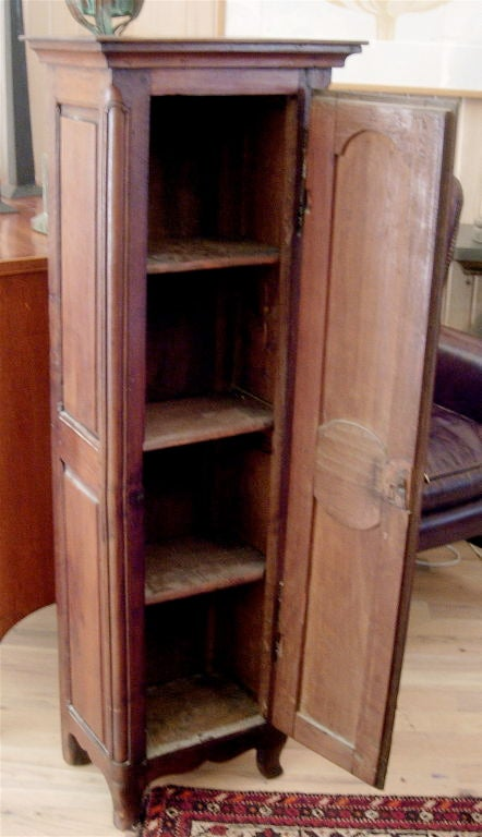 Charming diminutive French Provincial walnut cabinet.