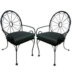 EXCEPTIONAL SET OF EIGHT IRON WHEEL BACK PATIO CHAIRS