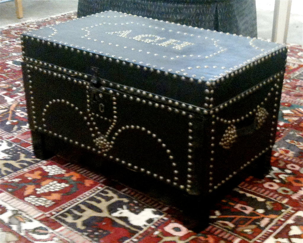 English 19th century leather-bound trunk on stand. Great for side table or small coffee table. 