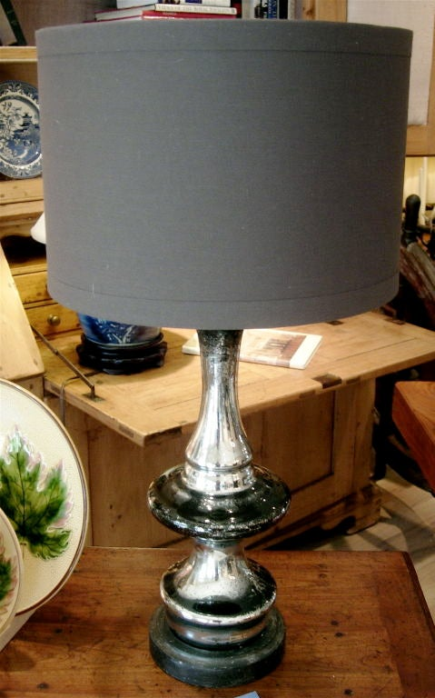 Handsome mercury glass lamps mounted on wood bases, rewired, priced per lamp.