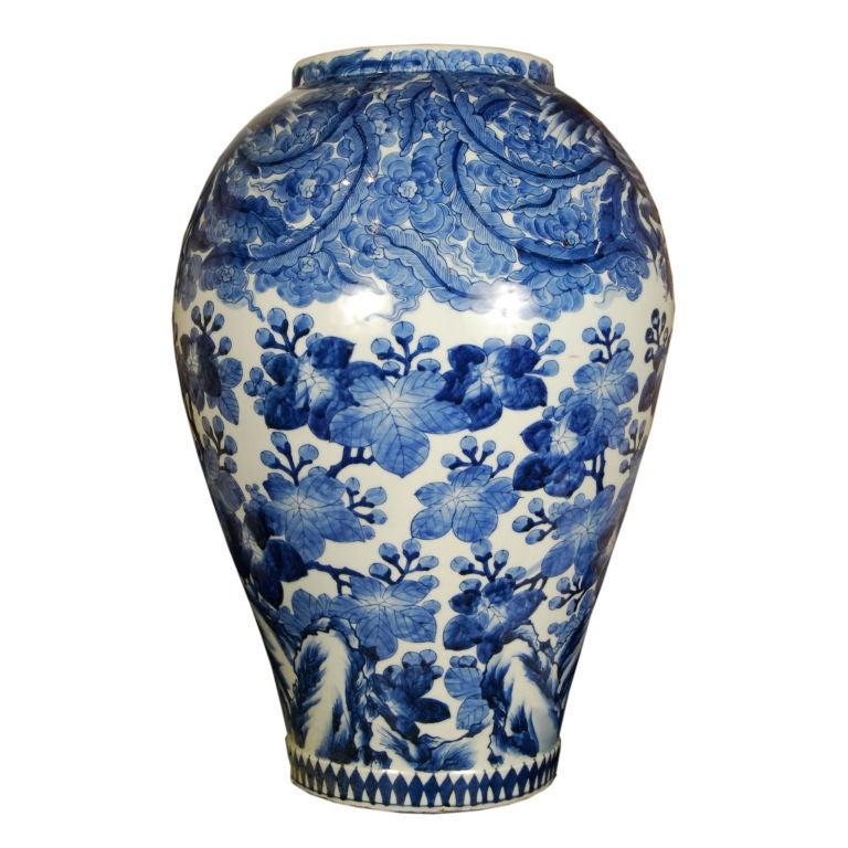 A 19th century Japanese blue and white glazed porcelain jar depicting phoenix amidst cherry blossoms.<br /> <br /> Pagoda Red Collection #:  BTG001<br /> <br /> <br /> Keywords:  Jar, vase, urn, vessel, planter, Japan, Meiji