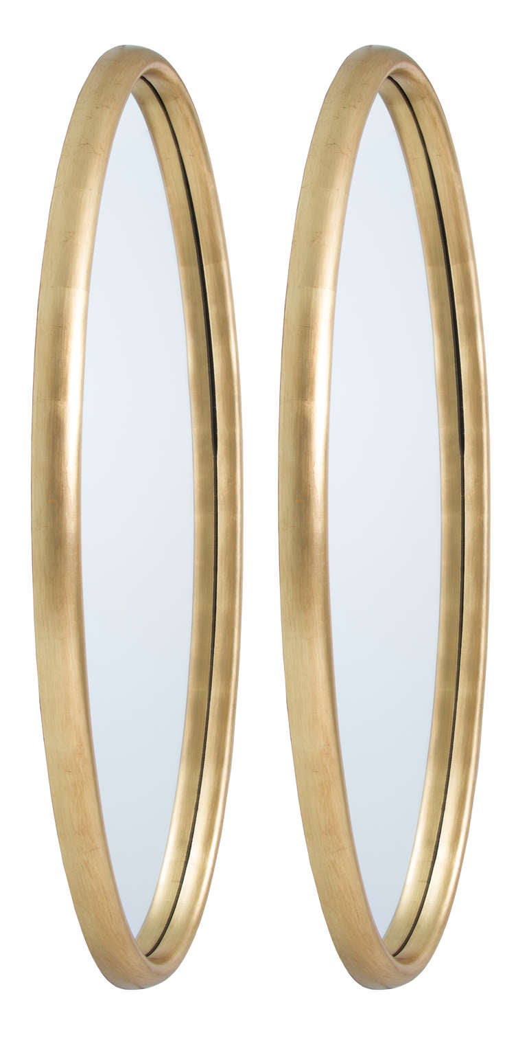 pair of long gold gilt oval mirrors for sale at 1stdibs