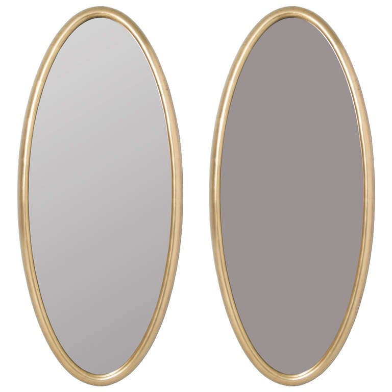 pair of long gold gilt oval mirrors at 1stdibs