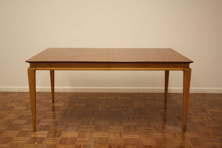 Midcentury cheerywood dining table by Renzo Rutili for Johnson Furniture, three 11 inch leaves, two with aproned edge, one without.
