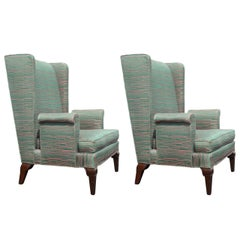 Pair of Tall Back Stylized Wingback Chairs Attributed to Grosfeld House