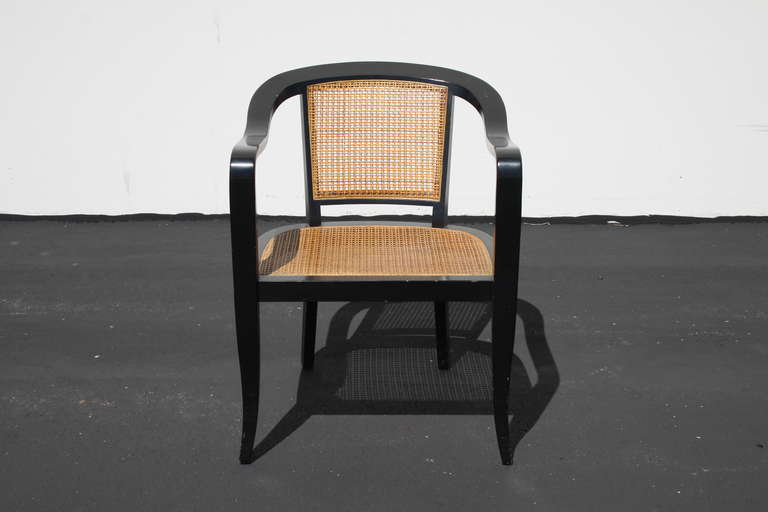 Pair of chairs in the style of Edward Wirmley, ebony frames with cane seats & back, light touch ups to frames.