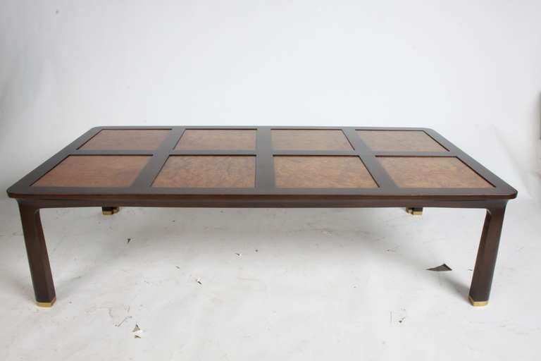 Edward Wormley walnut table in dark brown finish with Carpathian elm top and brass sabots, label, model number 6007.