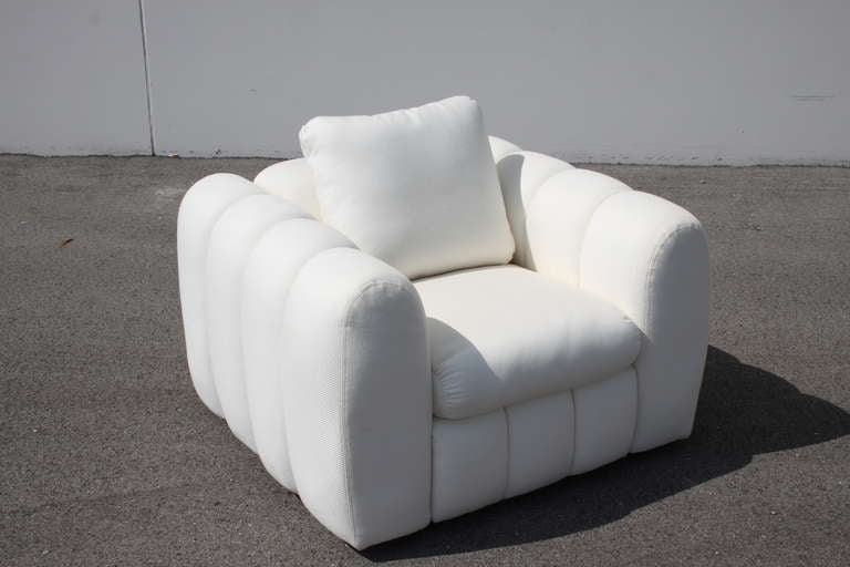 Pair of spectacular Hollywood Regency Art Deco style channeled club chairs by designer Jay Spectre for Century Furniture, labels, white fabric original in nice condition, minor specs to upholstery could probably be cleaned, arm height 26