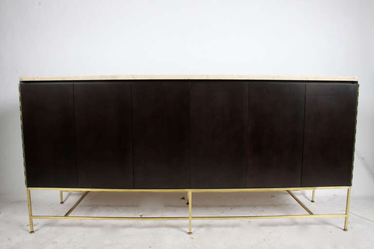 Brass base travertine top sideboard in dark brown finish on mahogany with accordion doors.  A second is also available with a wood top.