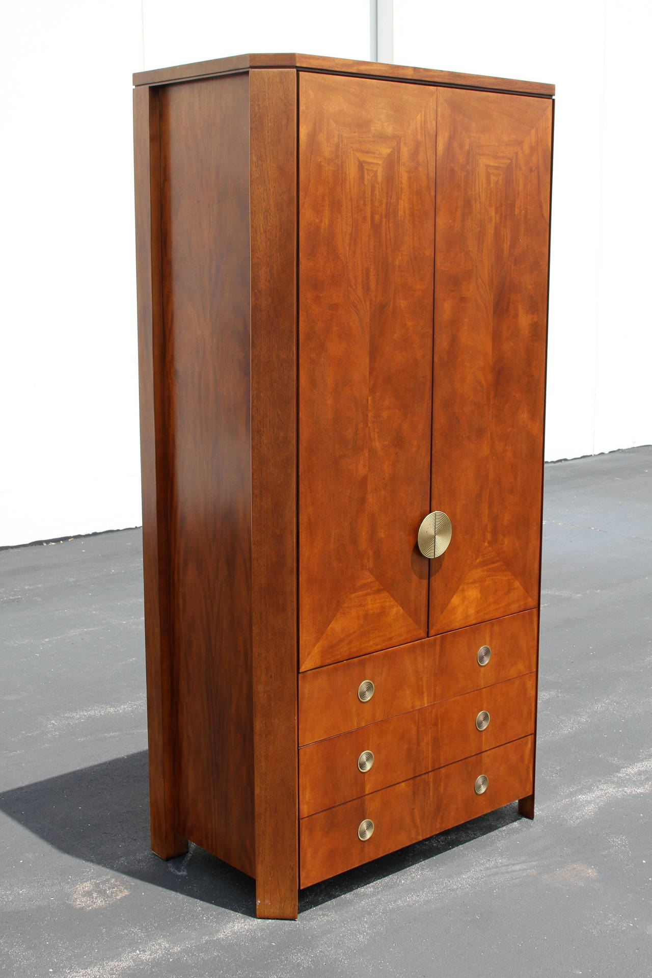 Delicieux Tall Skyscraper Form Armoire With Cabinet Doors Above Three Drawers, All  With Concentric Brass Circular. Modern Charles Pfister Armoire For Baker  Furniture ...