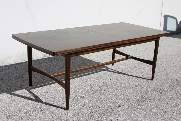 midcentury mahogany dining table with extension leaf for