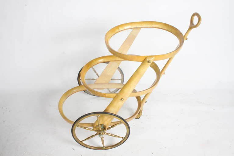 Lacquered goatskin cart with brass wheels.