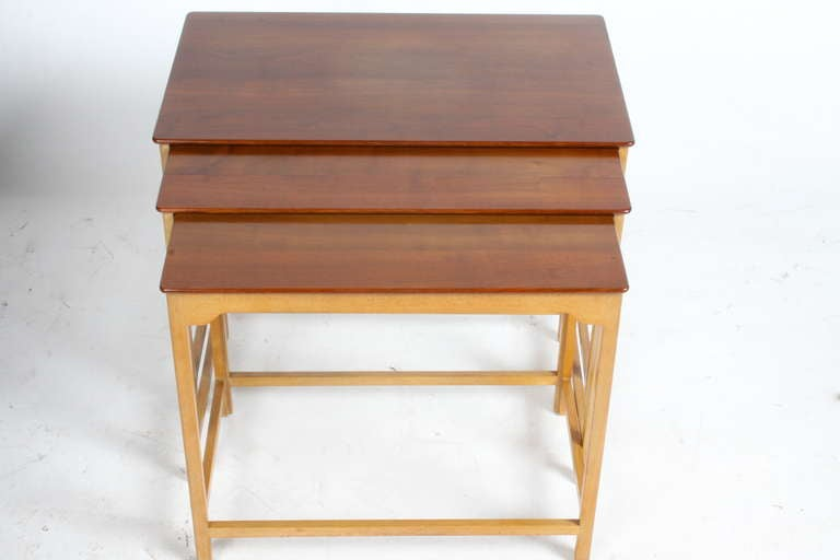 Set of three nesting tables designed by Edward Wormley for Dumbar, late 1940s. Measures: 26.5 x 16 x 20.5 nested. 27.5 deep as pictured (open). 15 x 25.5 x 20 2nd biggest. 23.5 x 14 x 19.5 H smallest.