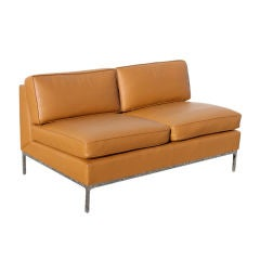 Pair of Nicos Zographos loveseats