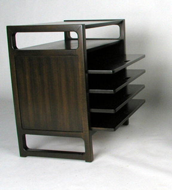 Edward Wormley magazine table with four pull-out shelves below an open shelf. Dark brown finish on silver elm. Pair available.