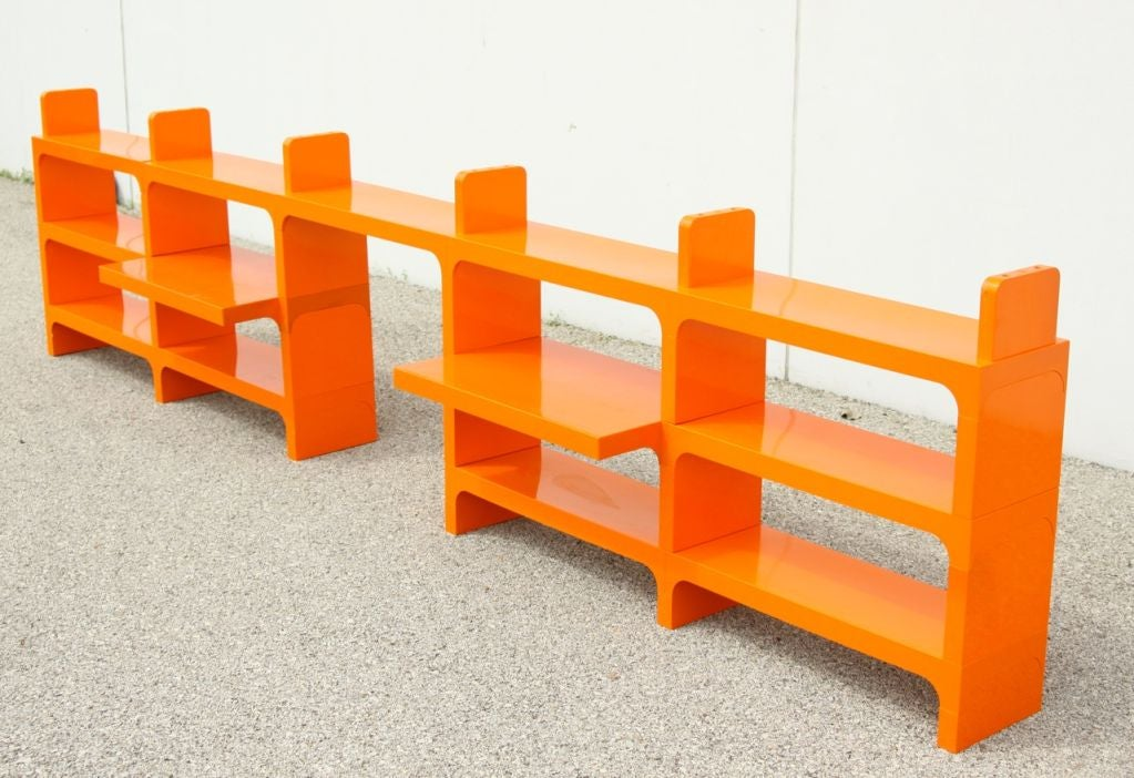 Orange Plastic Modular Bookcase With Multiple Component Parts That Can Be Assembled In Various Ways