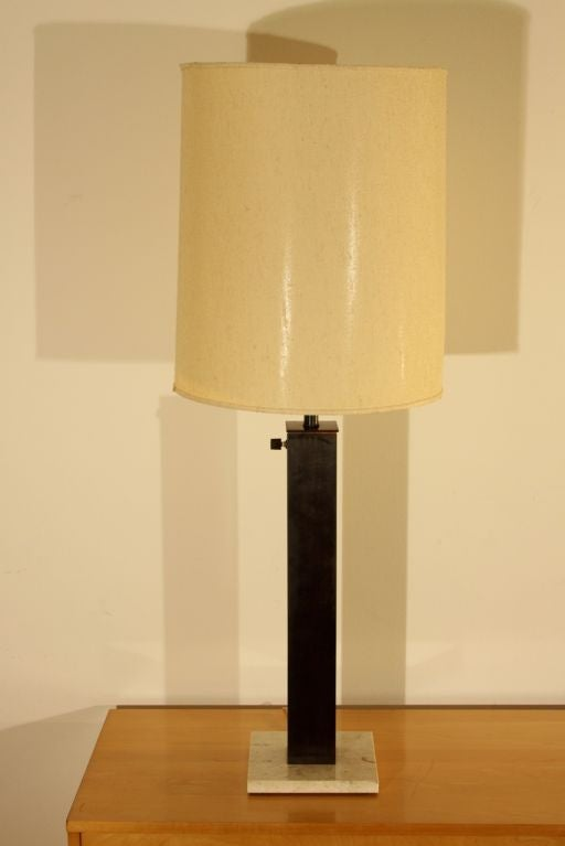 Matching pair of Nessen lamps, oiled bronze metal with marble bases, glass reflectors, fabric shades not included.