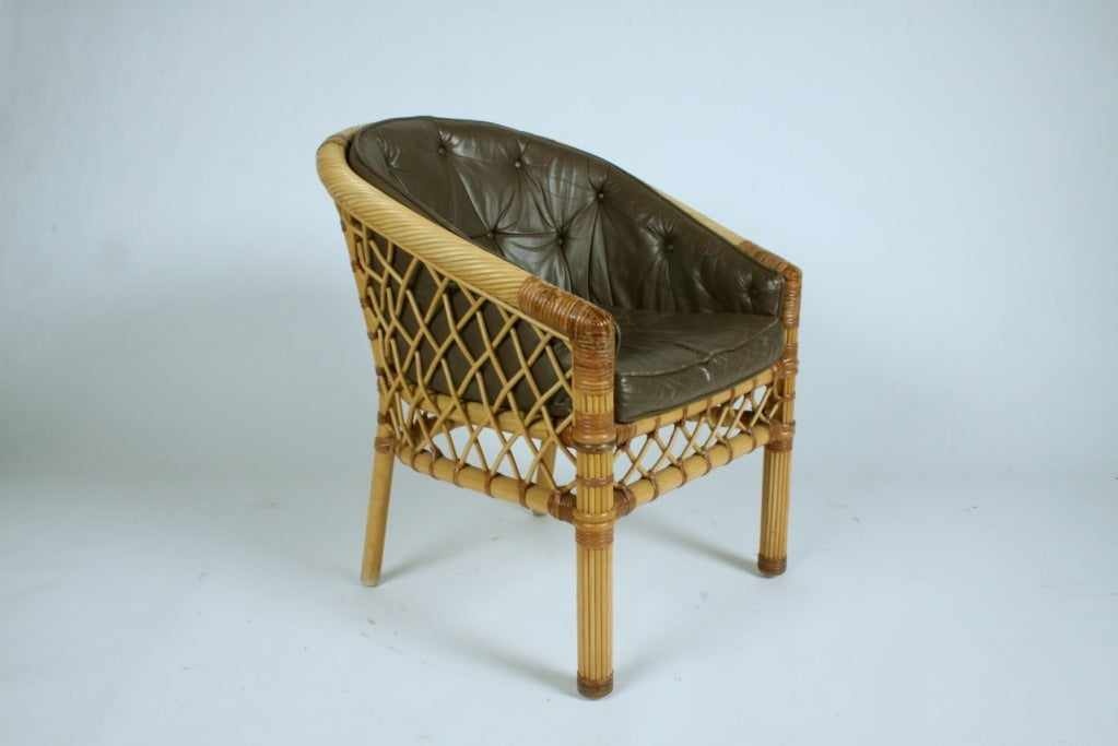 Pair of woven cane/ rattan frame chairs with leather cushions by Bielecky Bros.