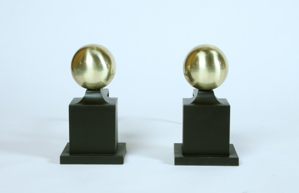 Pair of Andirons made by Wm. H. Jackson Company, designed in the 1920's, brass sphere on iron column.