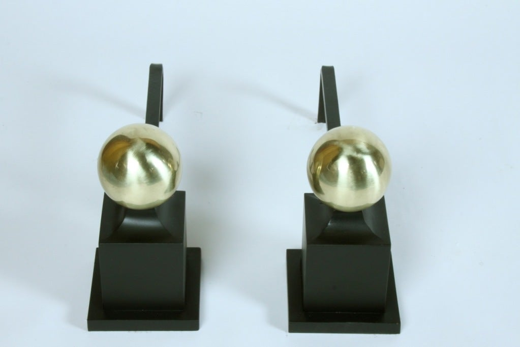 American Art Deco Andirions with brass spheres on iron columns
