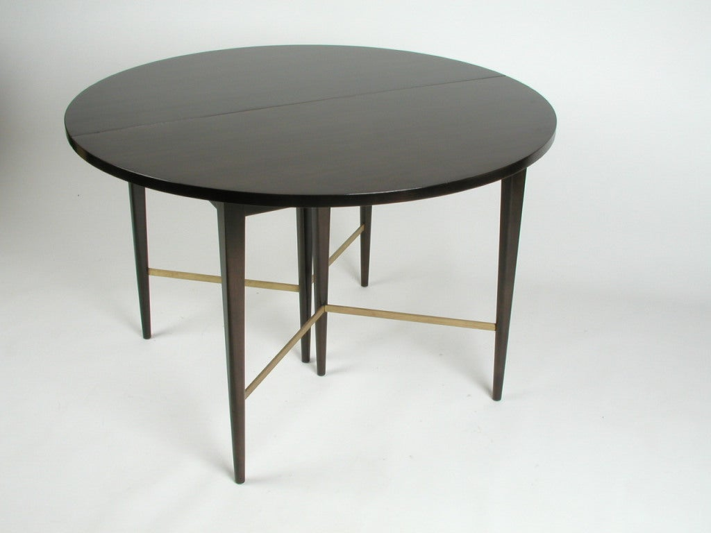 Paul mccobb round dining table with 6 extension leaves at for Dining table with two leaves
