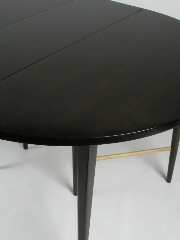 paul mccobb round dining table with 6 extension leaves at