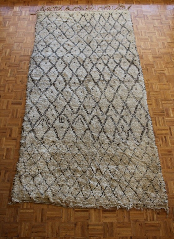 Moroccan hand-loomed wool rug, ivory with chocolate brown diamond design.