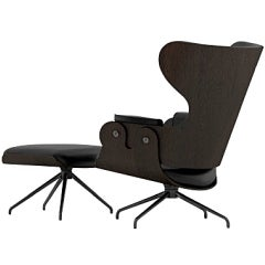LEATHERED SWIVEL LOUNGER W/ FOOTSTOOL BY JAMIE HAYON