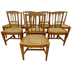 8 Italian 19th. c walnut canned seat dining chairs