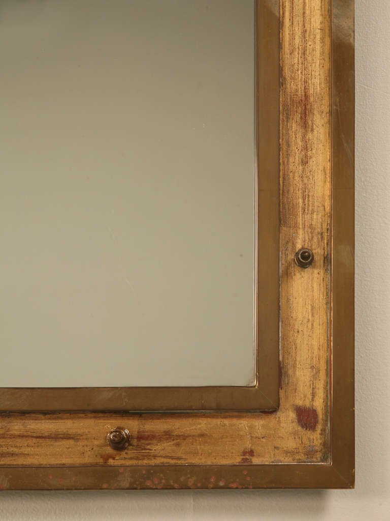 This italian circular wooden wall mirror is no longer available - Vintage French Industrial Brass Mirror With Rivet