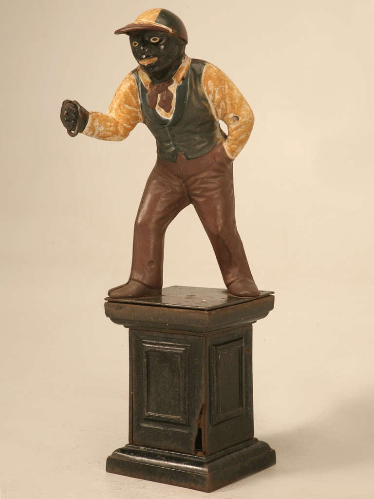 Fantastic original American lawn jockey portraying Jocko Graves a famous 12 year-old boy, that helped shape this great nation into what it is today. Wearing his worn paint, this fine Jocko hitching post offers a glimpse into the past. Utilized with
