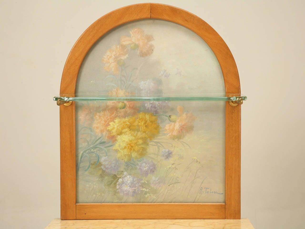 The flowers you see behind the glass were painted by Tolosa-Alina,  who was a well known Spanish painter and lived from 1861-1938. The cabinet was originally used in a bathroom and is in absolutely beautiful all original condition. Could also double