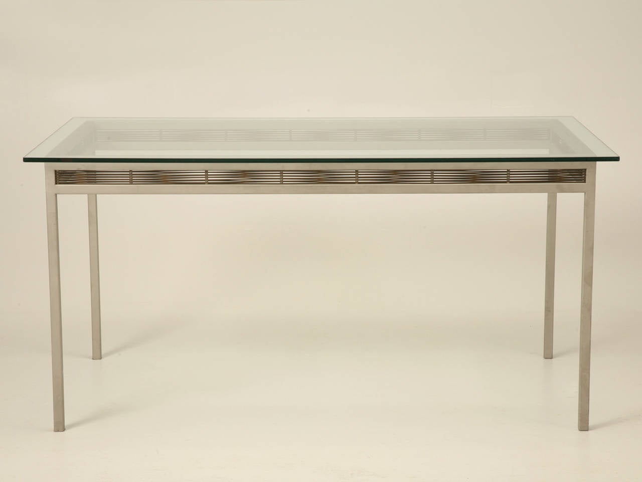Originally designed for the outside, but commonly used inside as well, this stainless steel table will last a lifetime. Designed and fabricated by the Heltzer company in Chicago, Illinois and manufactured to a very high standard.