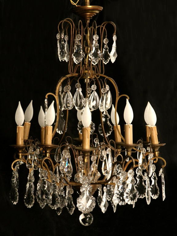 Vintage French crystal and bronze 10 light chandelier with a matching canopy and original chain. This particular chandelier is amazing, it's size is fantastic, and it's condition remarkable. Large hand-cut crystals, an exquisite scrolled frame, and