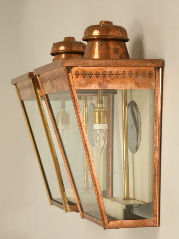 Magnificent pair of fully restored antique English copper coach or wall lanterns. These are wonderful with only slight tarnishing, you want them polished and lacquered or let them age and weather naturally to a great verde appearance. Whatever you