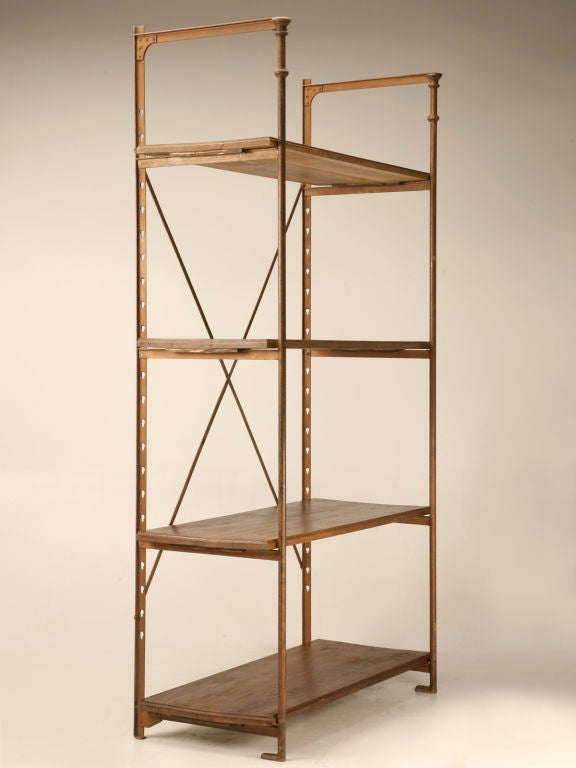 Fabulous industrial appearing antique French steel and wood shelving unit retaining it's original Parisian maker's tag. In original condition, we have not done anything to this unit, we haven't even waxed it. Perfect utilized most anywhere, an urban