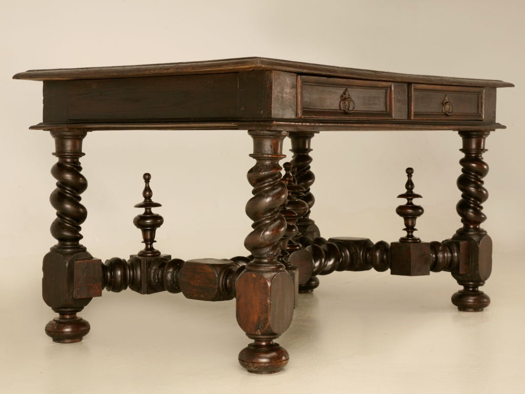 Extraordinary antique French 2 drawer Medieval style writing table offers quality solid oak craftsmanship paired with modern functionality. Spanish, Italian, or Mediterranean architecture would be an awesome backdrop of course minimalist works, too.