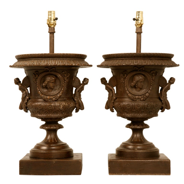 Magnificent Pair of Italian Iron Winged Maidens Urns Fitted as Lamps