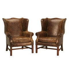 Outstanding Pair of Vintage Distressed Bomber Leather Wing Back Chairs