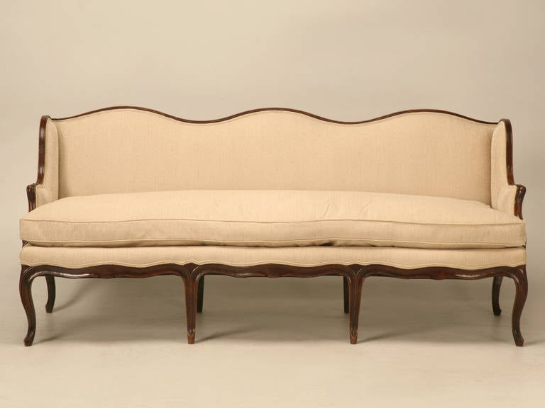 French walnut Louis XV sofa has over 120 man hours invested in its restoration of the wood alone, we totally disassembled the frame thoroughly cleaning each joint, and then we started the laborious chore of putting it back together so that the