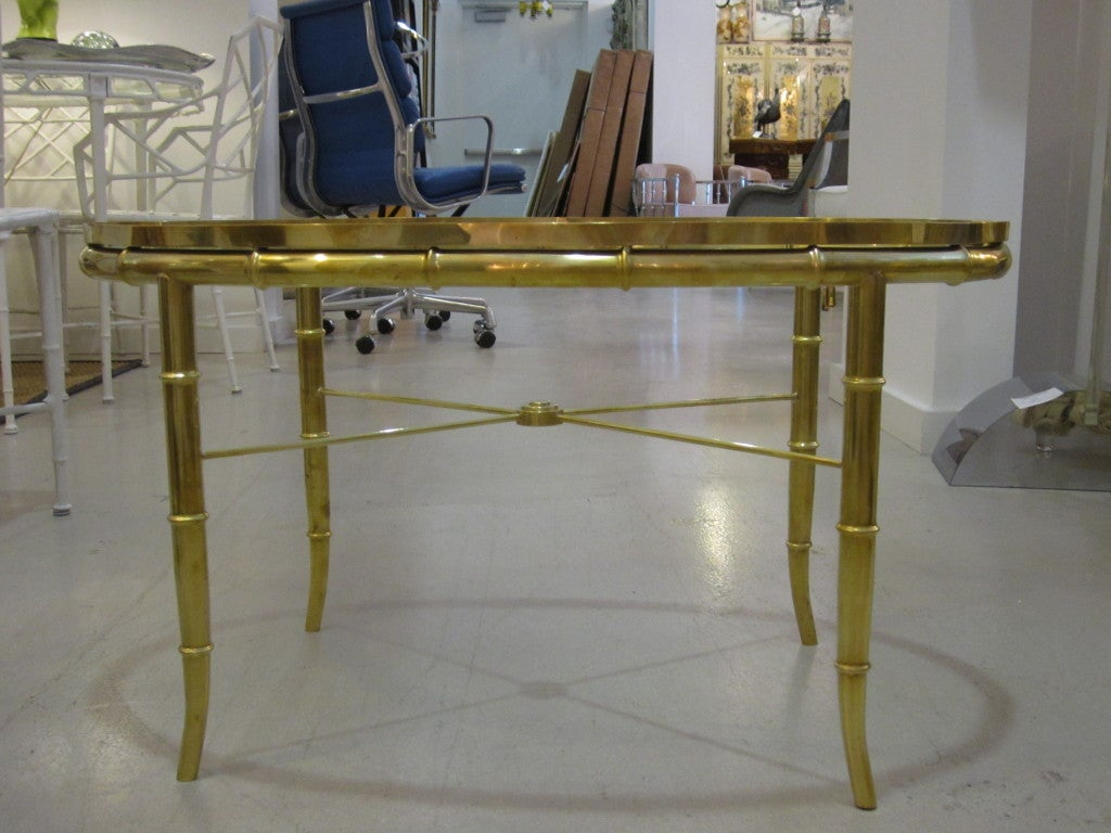 Mastercraft oval table polished brass table with faux bamboo motif.