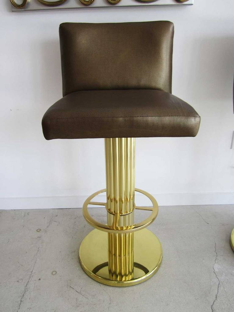Three mid century modern bar stools in the style of karl springer at