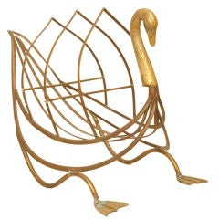 A Magazine/Newspaper Rack in the Form of a Patinated Brass Swan
