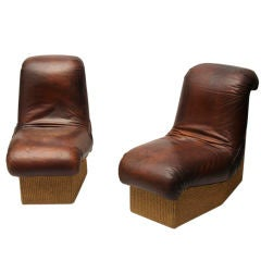 A Set of 5 French Leather Lounge Chairs with Rope Covered Bases