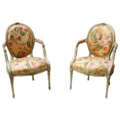 A Pair of English George the III Style Oval Back Open Armchairs