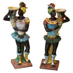A Pair of Porcelain Blackamoor Figures in 18th Century Costume
