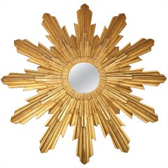 An Italian Round carved gilt wood sunburst mirror