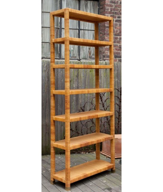 A contemporary design Bielecky 7 tiered rattan etagere with square wrapped frame and open weave rattan shelves.